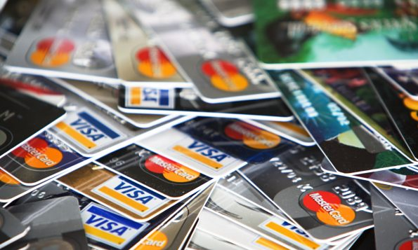 Pile of Visa and MasterCard credit cards| Point Hacks