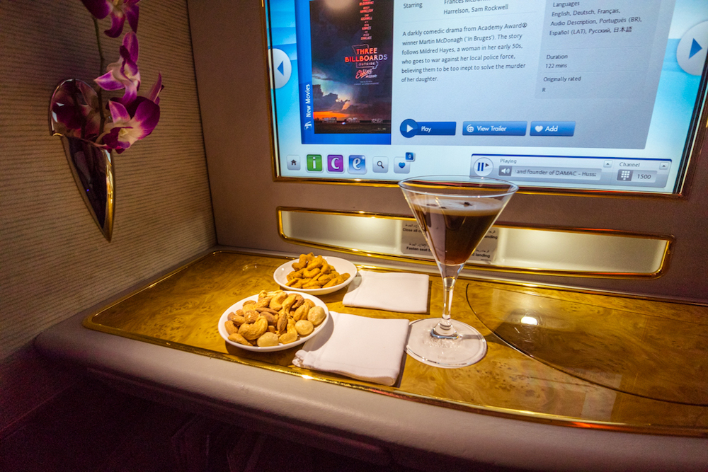Emirates 777 First Class nuts and drink