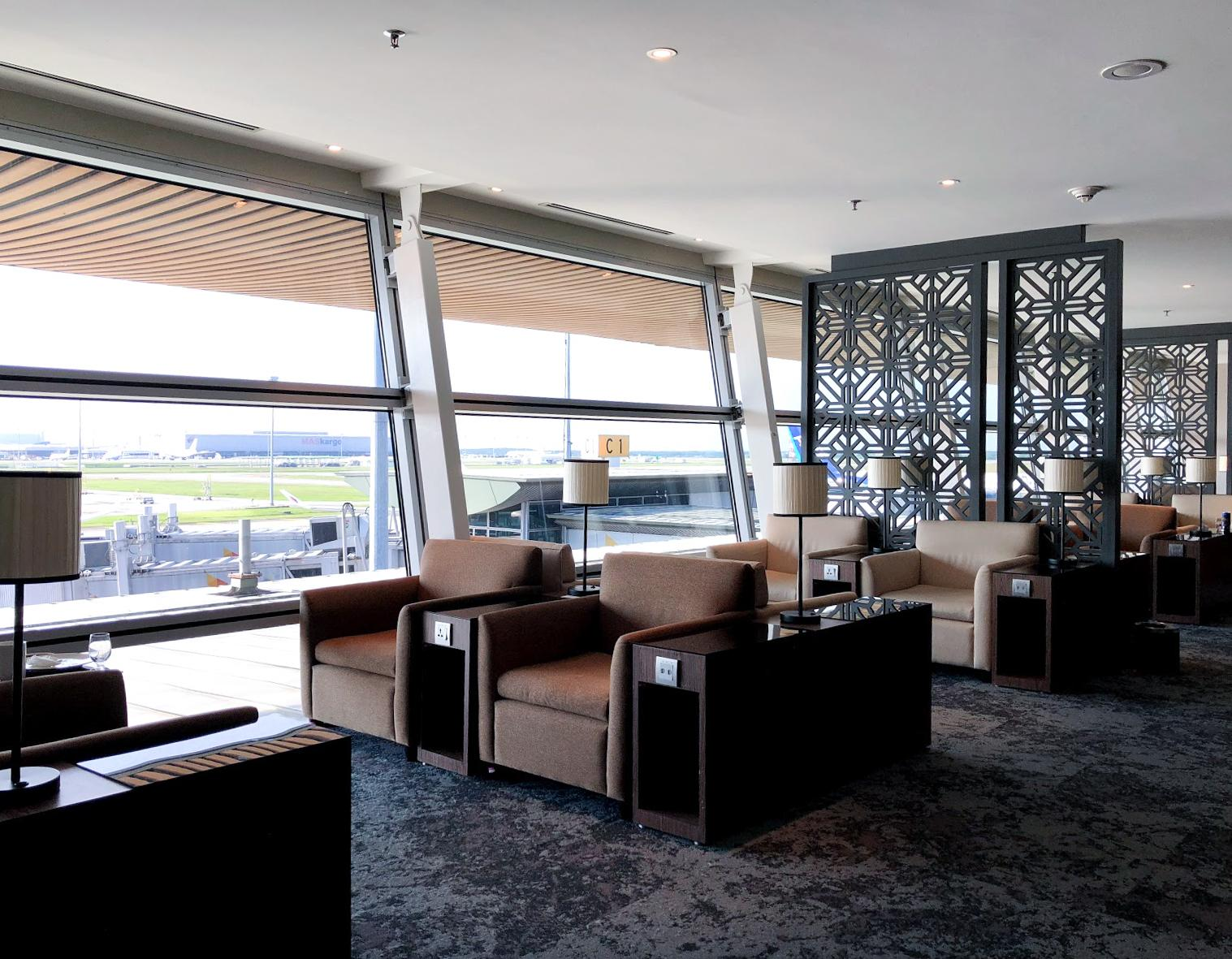 Malaysia Airlines Satellite Golden Lounge Kuala Lumpur seating area with tarmac view