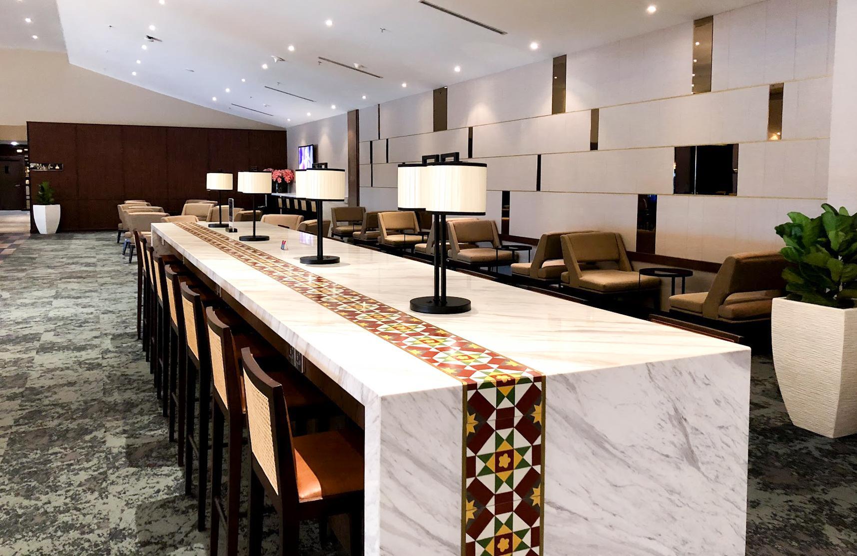 Malaysia Airlines Satellite Golden Lounge Kuala Lumpur high bar table