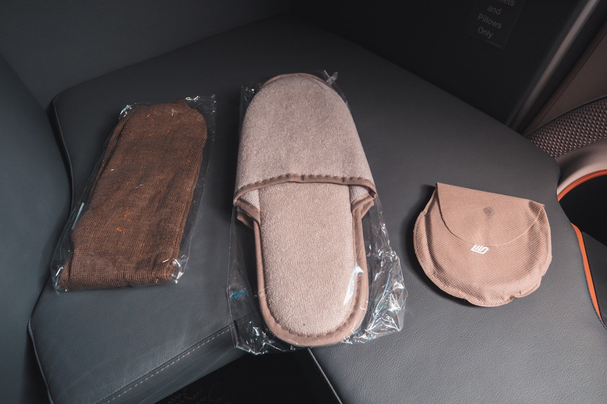 Singapore Airlines slippers, socks and eyemask
