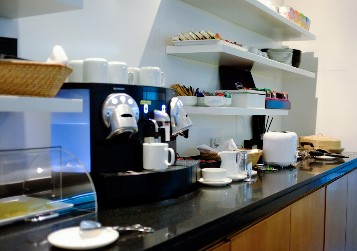 Cathay Pacific Business and First Class Melbourne Lounge self-service coffee maching and tea station