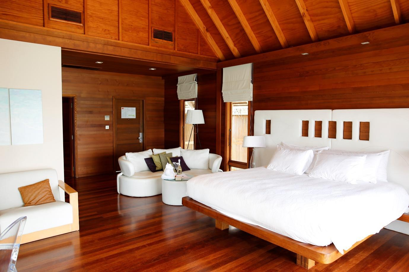 Conrad Rangali Maldives living area and bed