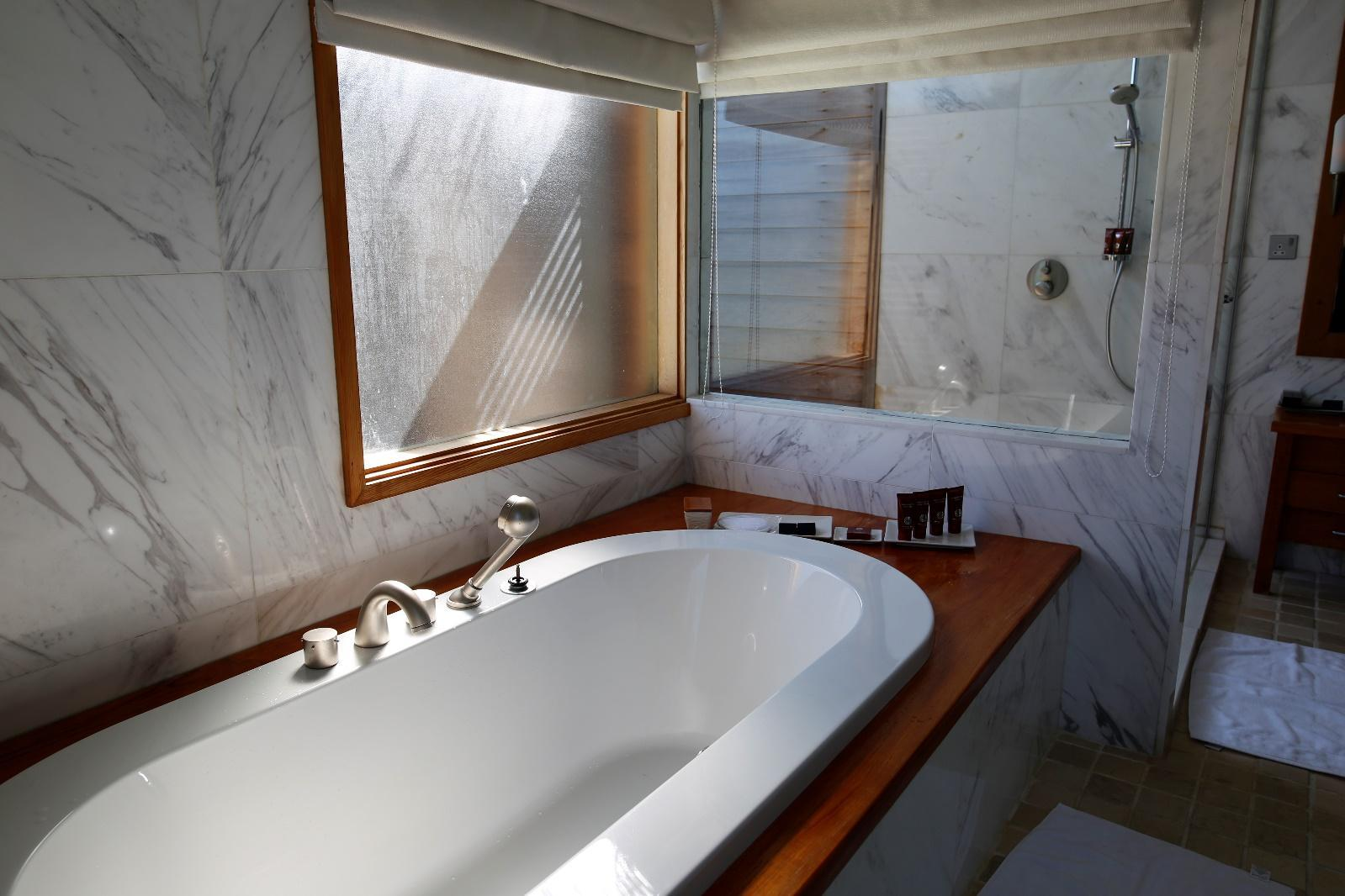 Conrad Rangali Maldives Sunset Water Villa bathtub at bathroom 2