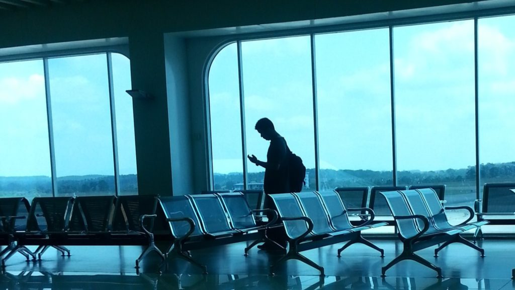 Person Waiting at Airport