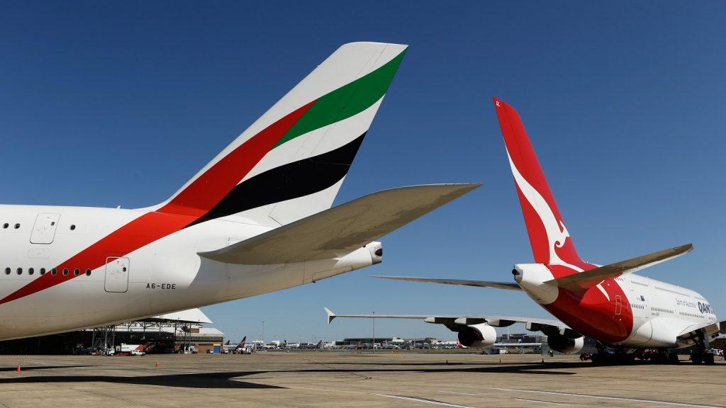 Emirates and Qantas planes on tarmac