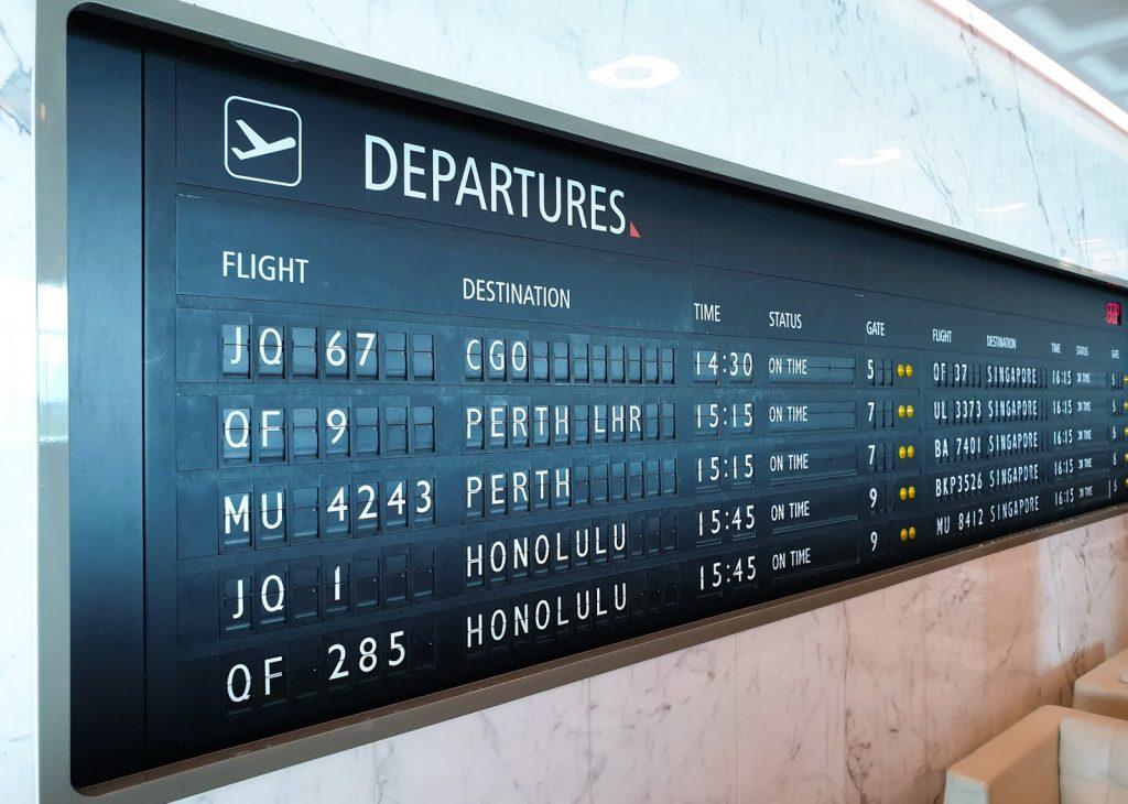 Qantas Melbourne First Lounge information board