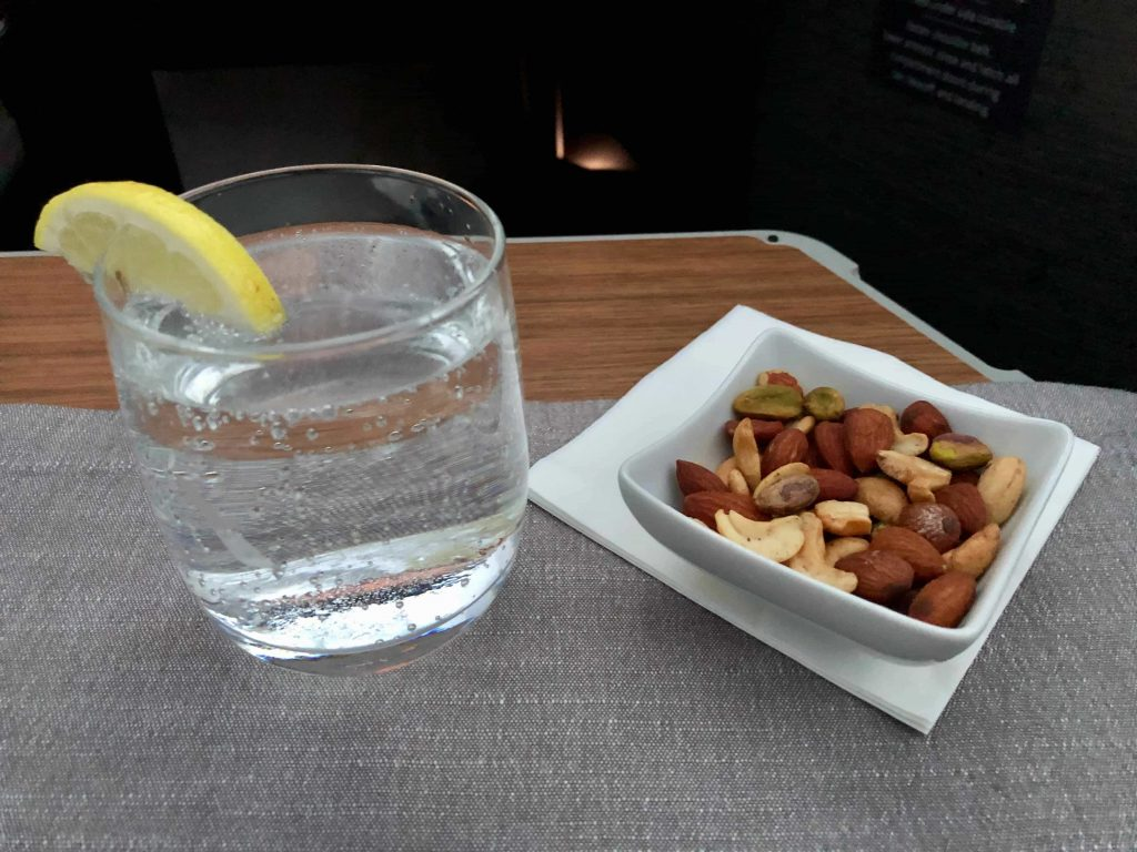 American Airlines 787-9 Business Class welcome drink and nuts