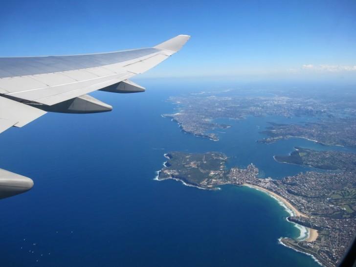Plane wing over Sydney